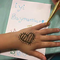 Heart shaped henna on a little hand in Eid al-Adha Celebration.