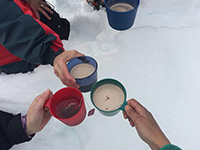 Hot cocoa is served on snow