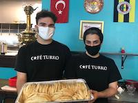 Cafe Turko employees are delivering the food.